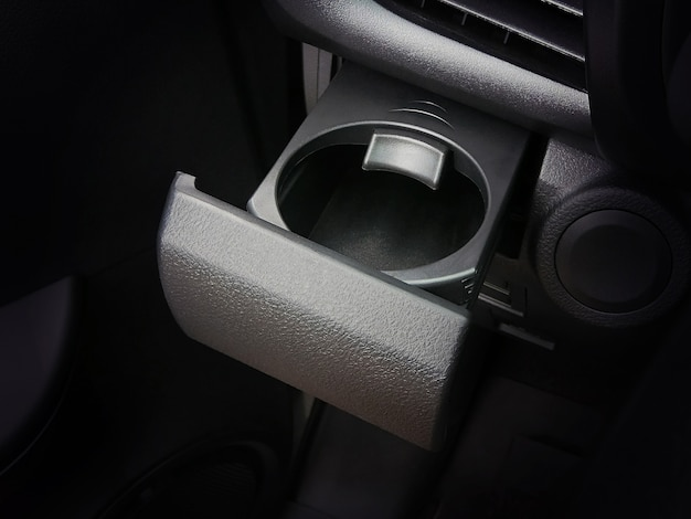 Cup holder in the car with a lock. Premium Photo
