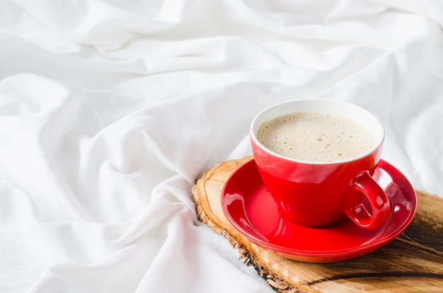 Cup of hot cappuccino. breakfast in bed. Premium Photo