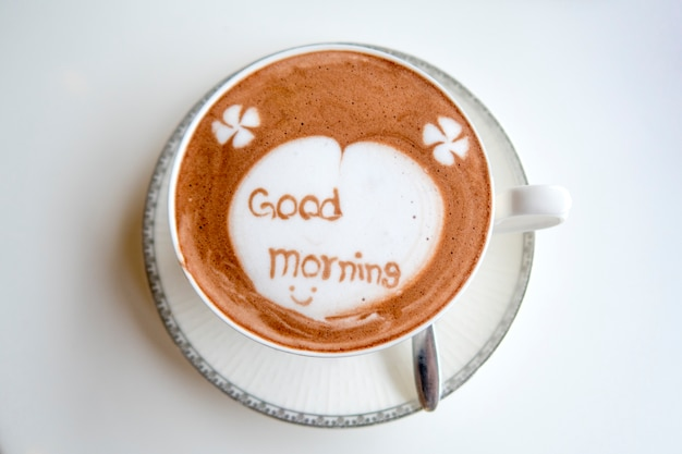 "Cup of hot chocolate with ""good morning"" message on white table background. Premium Photo"