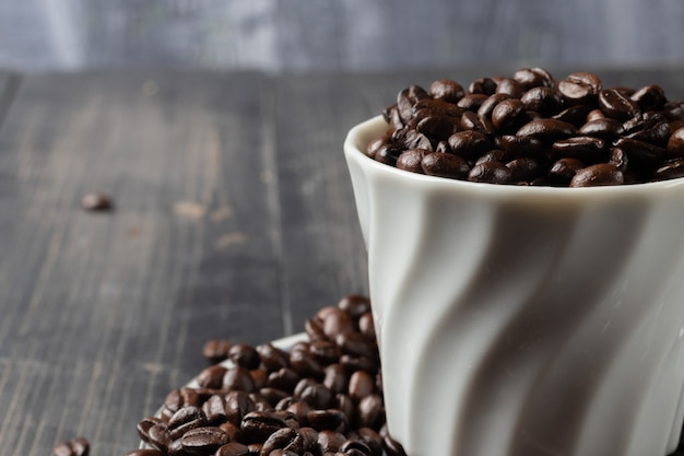 Cup of hot coffee and roast coffee beans Premium Photo
