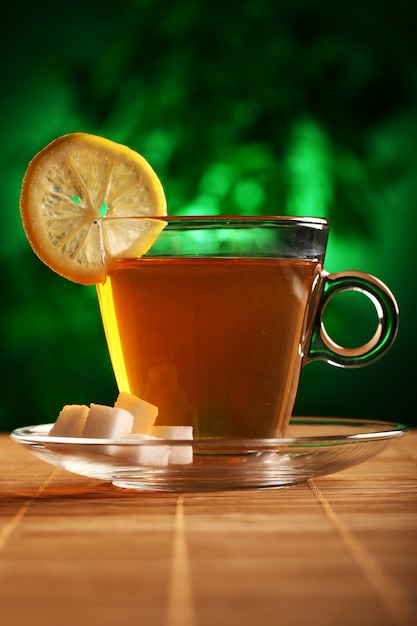Cup of hot green tea with sugar and lemon Free Photo