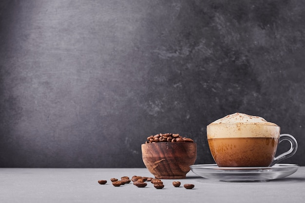 A cup of latte isolated on grey background. Free Photo