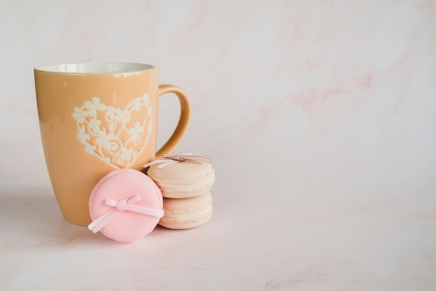 Cup and macaroons cookie Free Photo