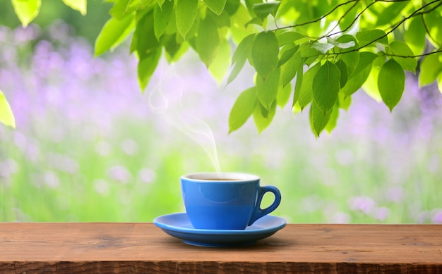 Cup of aromatic coffee outdoors Free Photo
