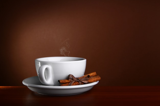 Cup og hot coffee on brown background Premium Photo
