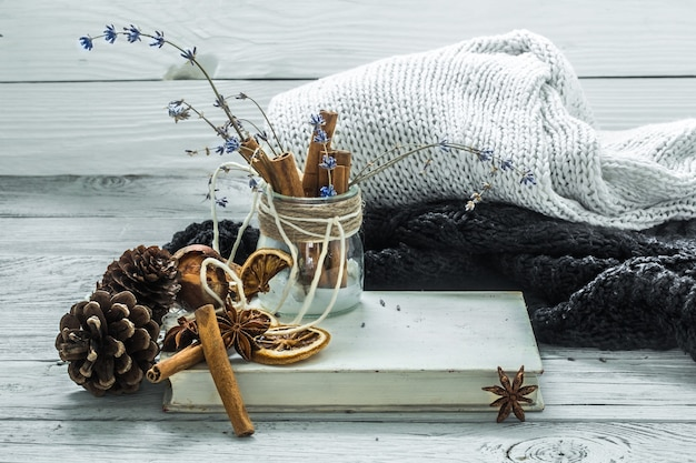 The cup of tea on a beautiful wooden background with winter sweater, old book , winter ,autumn, close-up Free Photo