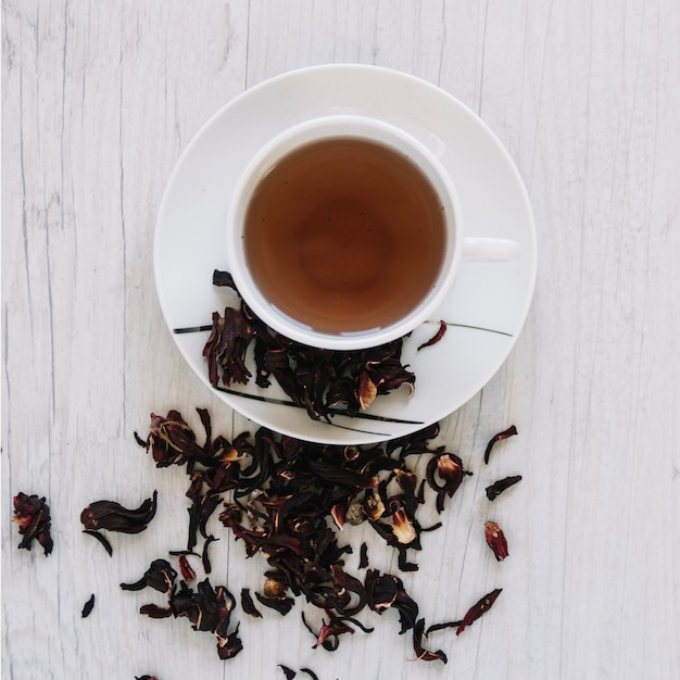 Cup of tea and dried tea leaves Free Photo