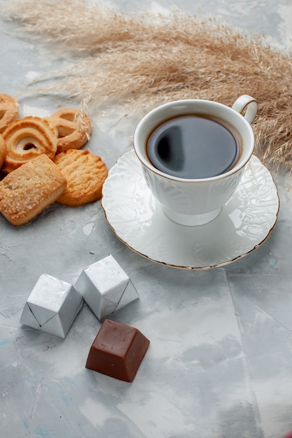 Cup of tea hot with chocolate and cookies on light, cookie candy chocolate tea cookie Free Photo