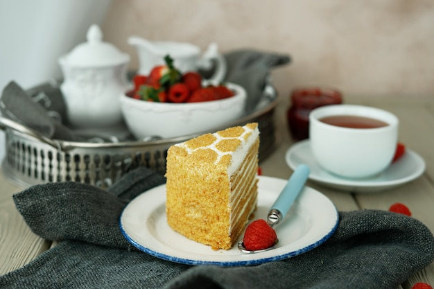 A cup of tea and a piece of cake in the cafe Premium Photo