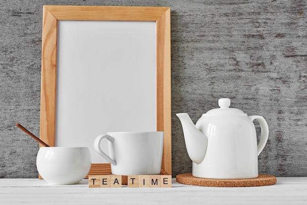 Cup of tea, teapot, sugar bowl, mockup Premium Photo