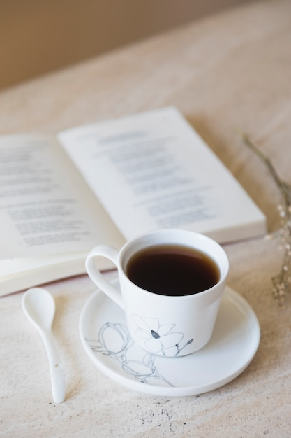 Cup of tea with book Free Photo