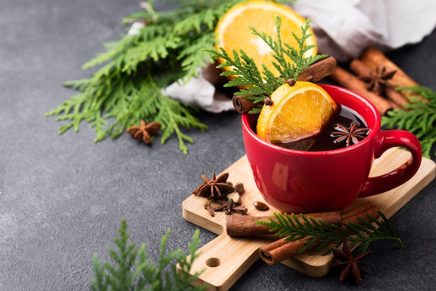 Cup of tea with lemon and fruits Free Photo