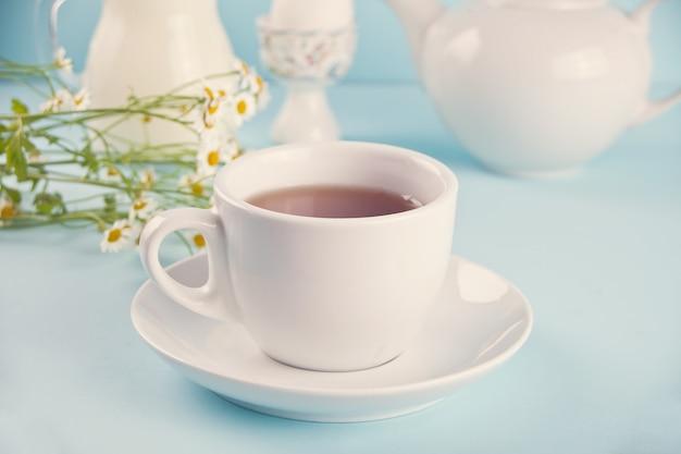Cup of tea with milk Premium Photo