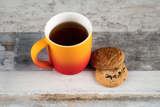 A cup of tea with oatmeal cookies Free Photo
