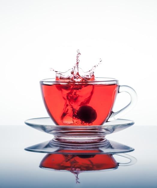 Cup of tea with splashes Premium Photo