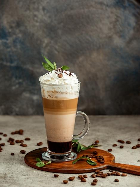 Cup of three layered coffee on dark Free Photo