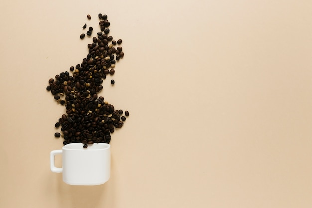 Cup with coffee beans and copy space Free Photo
