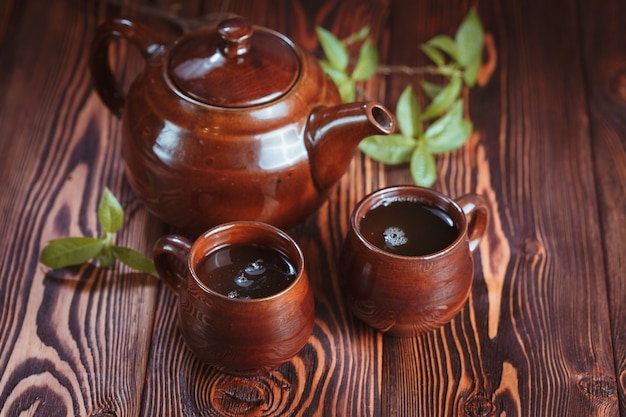 Cup with green tea on wood Premium Photo