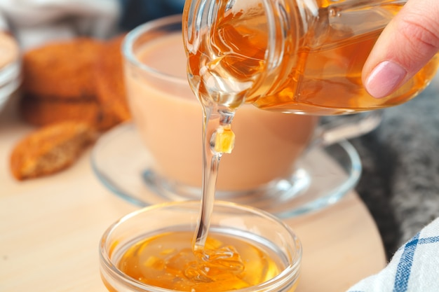 Cup with herbal tea and honey and dry herbal tea Premium Photo