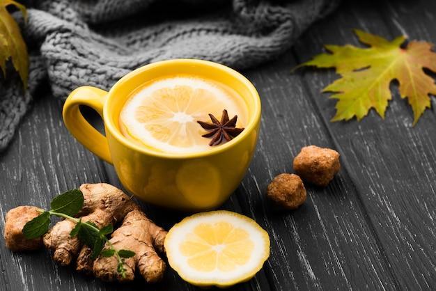 Cup with lemon tea aroma on table Free Photo