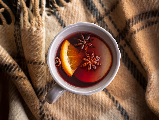 Cup with mulled wine and condiments Free Photo