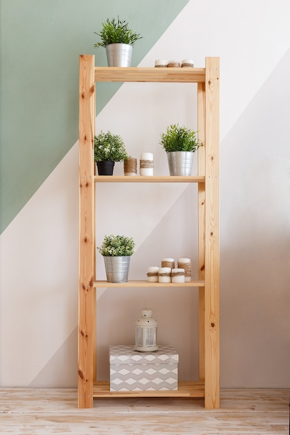Cupboard decorated with candles, green plants Premium Photo