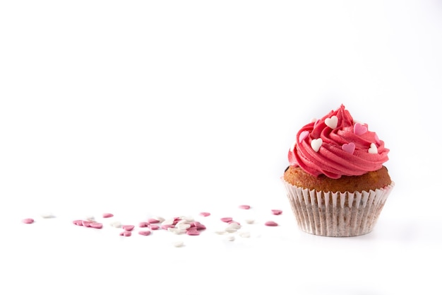 Cupcake decorated with sugar hearts for valentine's day isolated on white background Premium Photo