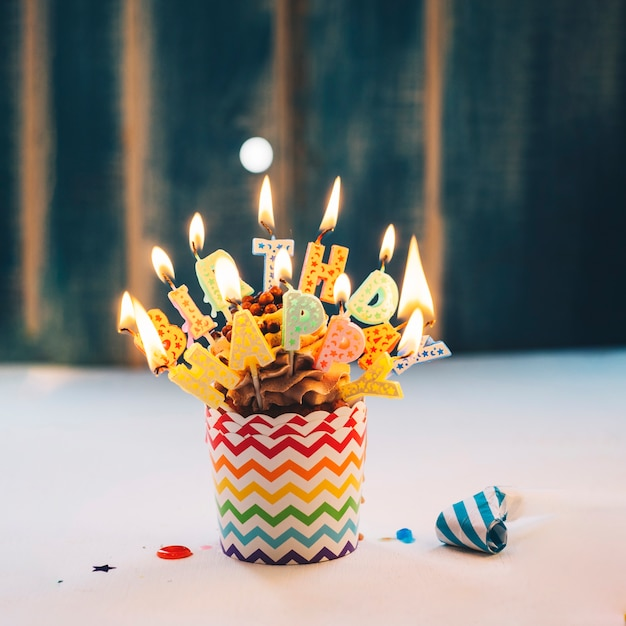 Cupcake with lighting Happy Birthday candles Free Photo