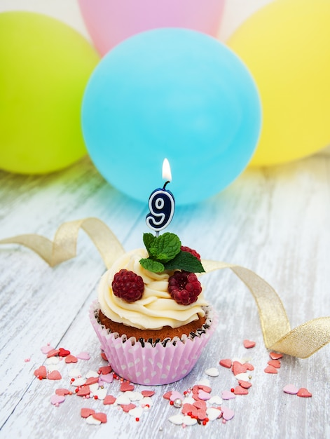 Cupcake with a numeral nine candle Premium Photo