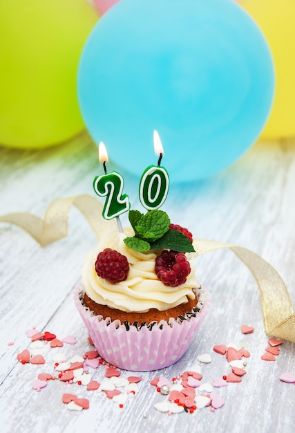 Cupcake with a numeral twenty candle Premium Photo