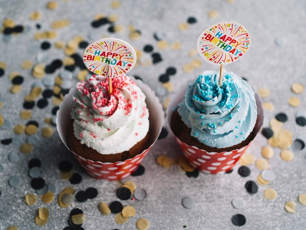 cupcakes with colorful cream and happy birthday signs photo free
