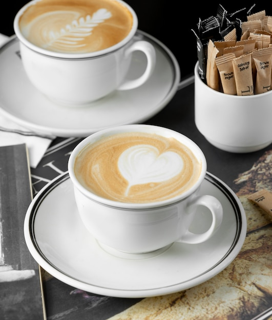 Cups of cappuccino with heart and rosetta latte art Free Photo