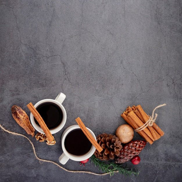 Cups of coffee with cinnamon and spices Free Photo