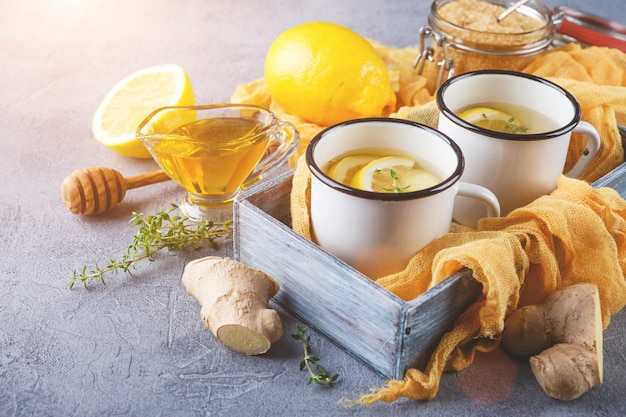 Cups of ginger tea with honey and lemon Premium Photo