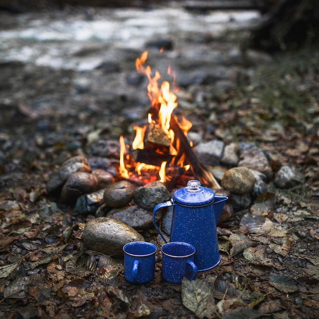 Cups and pot near fire Free Photo