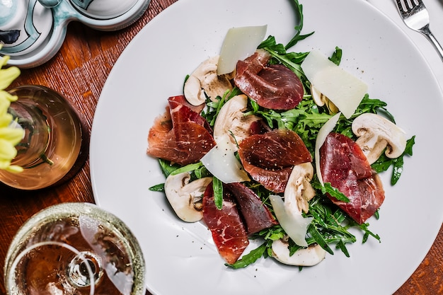 Cured meat with rocket mushroom and parmesan Free Photo