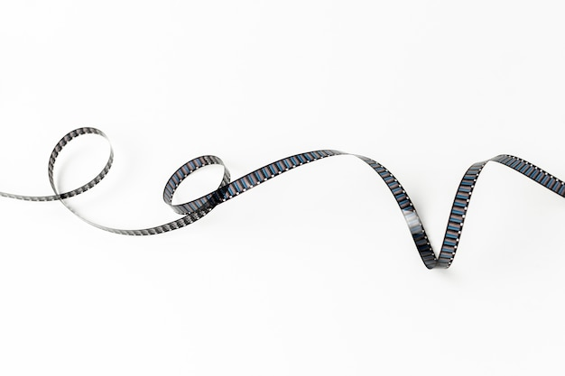 Curled filmstrip isolated on white background Free Photo