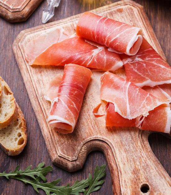 Curled slices of  prosciutto Premium Photo