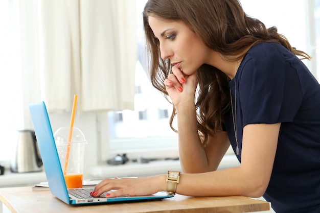 Curly girl with laptop Free Photo