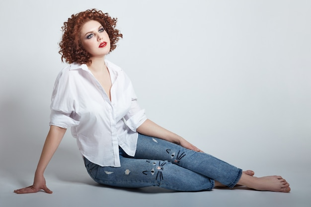 Curly redhead adult sexy woman in white shirt Premium Photo