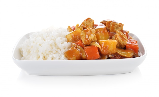 Curry and rice on white background. Premium Photo