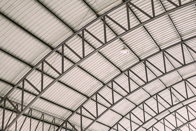 Curve roof steel design structure with galvanized corrugated roofing tile steel sheet. Premium Photo