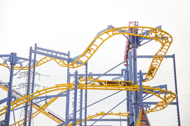 Curved rollercoaster tracks at the clear sky Free Photo