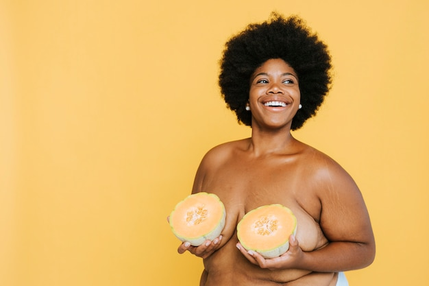 Curvy african american woman with melons Premium Photo