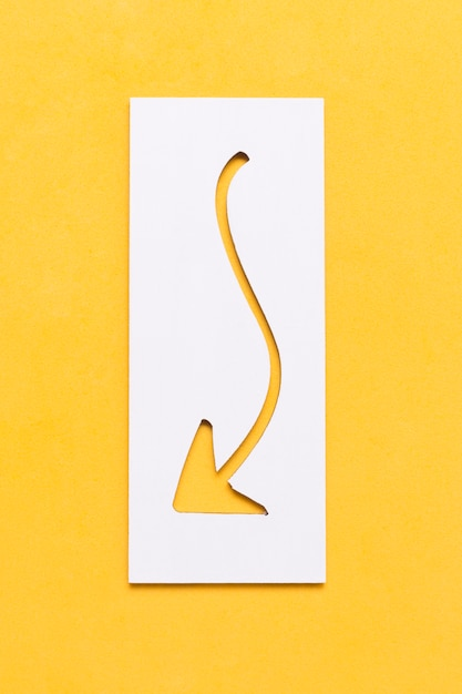 Curvy arrow curved in paper pointing down Free Photo