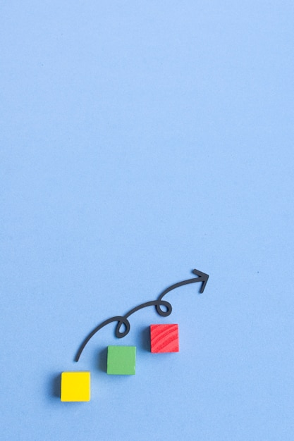 Curvy line arrow pointing up and colorful cubes Premium Photo