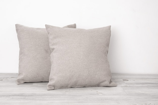 Cushions on the wooden surface Premium Photo
