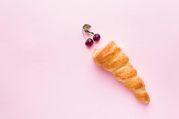 Custard cakes with cherries on pink Premium Photo