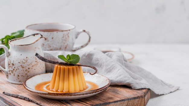 Custard on plate with mint and tea Free Photo