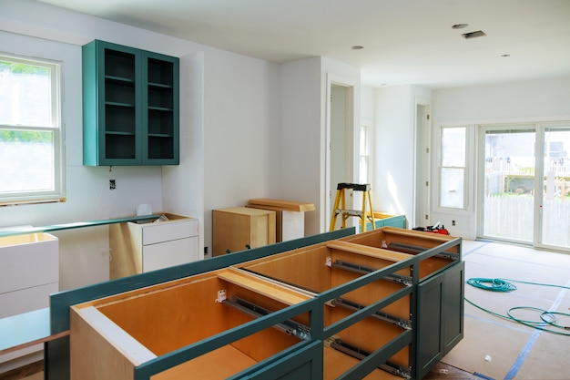 Custom kitchen cabinets in various stages of installation base for island in center Premium Photo